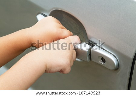 Hands of a child pulling the handle vehicle