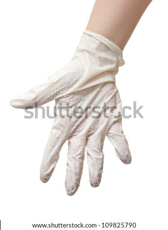 Hands of a doctor in a sterile gloves and drops of water - stock photo