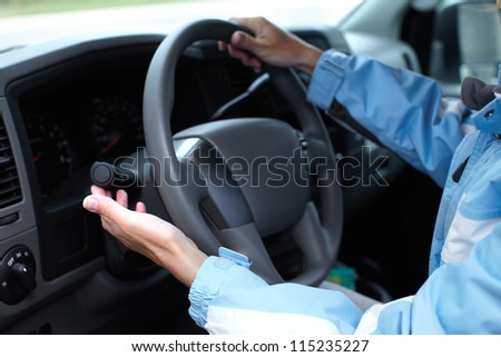Hands of a driver woman. Driving.