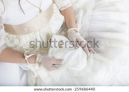 Hands of a little girl in the First Communion Day - stock photo