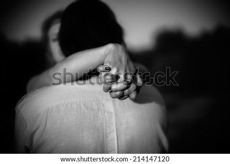 hands of a loving couple - stock photo
