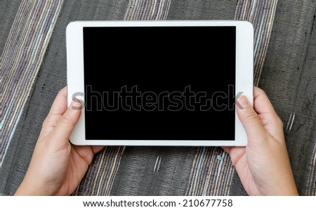 hands of a man holding blank tablet device - stock photo