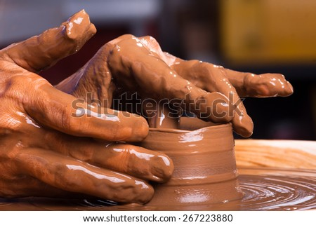 Hands of a potter, creating a clay jug - stock photo