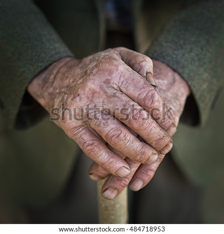 hands of a senior man on cane