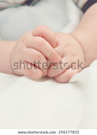 Hands of a small child. Baby's hands.