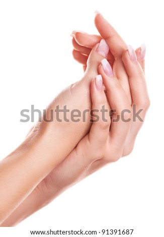 hands of a woman applying body lotion, isolated against white background