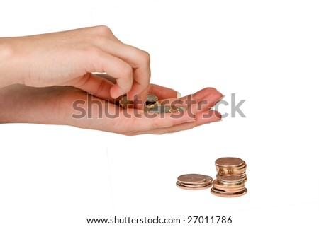 Hands of a woman counting money coins - stock photo