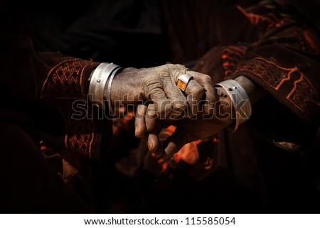 Hands of a woman nomad in the desert - stock photo