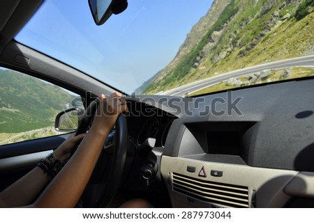 Hands of a woman on a wheel driving