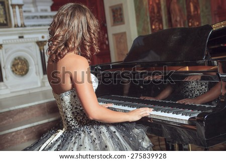 Hands of a woman playing the organ - stock photo