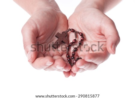 Hands of a woman Praying with Rosary, isolated on white