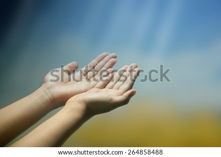 Hands of a woman reaching to towards sky, vintage style - stock photo