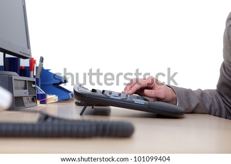 Hands of a woman using the computer keyboard - stock photo