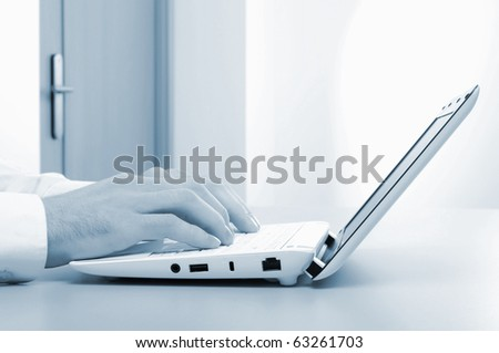Hands of a young girl running on a computer in the office