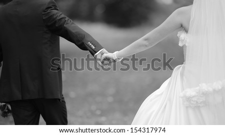 hands of a young newly wed heterosexual couple - stock photo