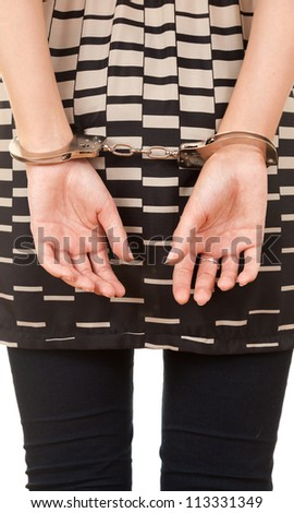 hands of a young woman in handcuffs, white background