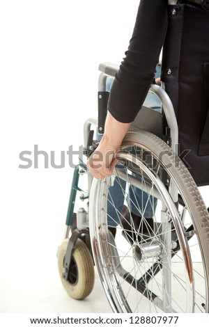 hands of a young woman sitting on a wheelchair, white background