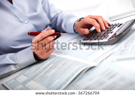 Hands of accountant business woman with calculator. - stock photo