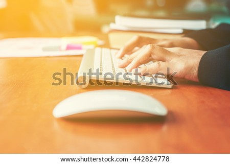 Hands of an office woman typing and work. - stock photo