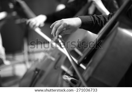 Hands of bassist playing
