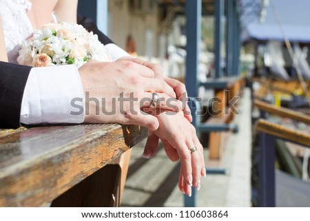 hands of bride and groom - stock photo