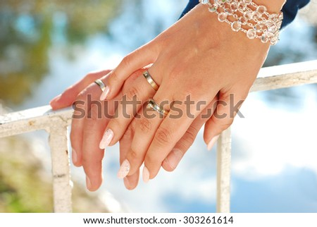 hands of bride and groom with wedding rings on fingers  - stock photo