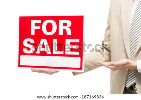 Hands of broker holding for sale signboard - stock photo