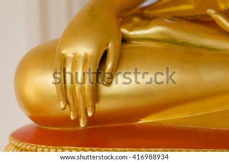 Hands of Buddha statue - stock photo