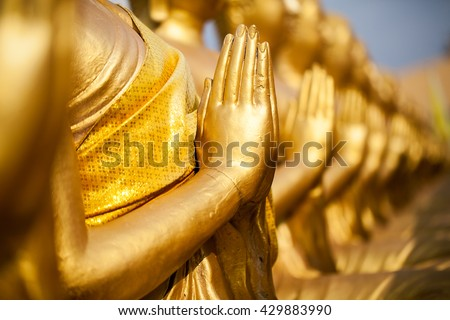 Hands of buddha statue - stock photo