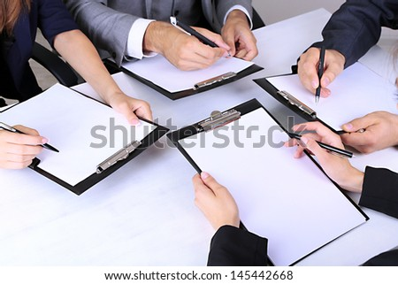 hands of business people at work in the office close up - stock photo