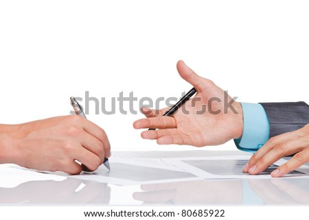 Hands of business people in elegant suits sitting at desk working in team together, with documents sign up contract, on clipboard, folder with papers, business plan. Isolated over white background. - stock photo