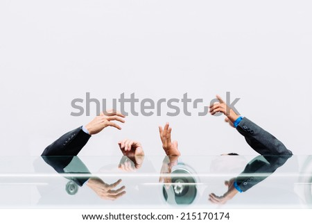 Hands of business people negotiating while standing on the balcony, view from below - stock photo