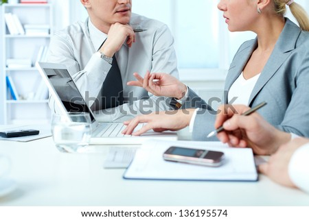 Hands of business people working at meeting - stock photo