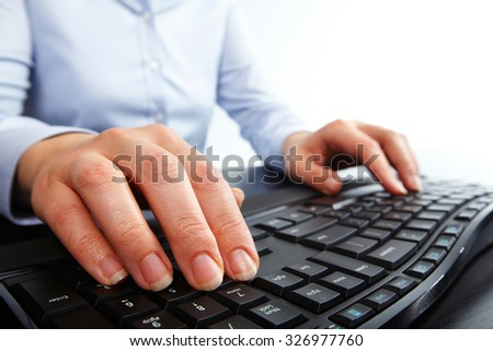 Hands of business woman typing on computer keyboard. Isolated white. - stock photo