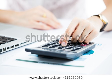 Hands of business woman with laptop computer keyboard