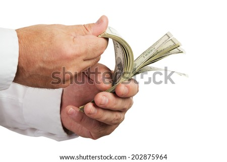 Hands of businessman holding and counting money isolated on white background.Selective focus. - stock photo