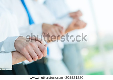 hands of businessmen, businessmen hold hands, stand in a row, the concept of teamwork - stock photo