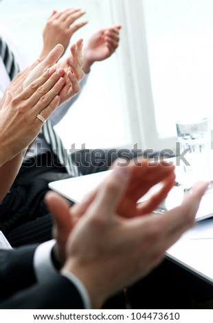 Hands of businesspeople applauding during a business meeting - stock photo