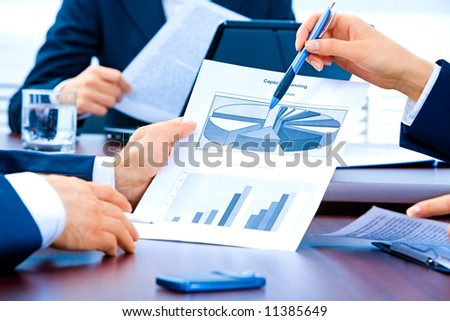 Hands of businesspeople during discussion - stock photo