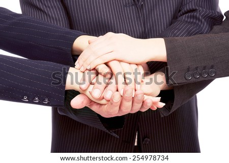 Hands of businesspeople together, closeup - stock photo
