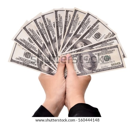 hands of businesswoman carrying a lot of money dollars, isolated on white background - stock photo