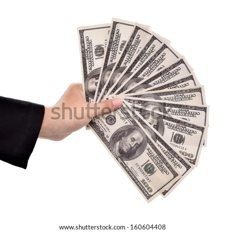 hands of businesswoman carrying a lot of money dollars, isolated on white background