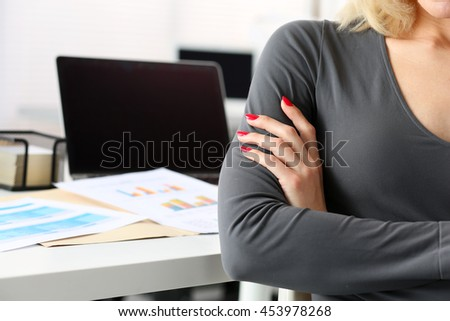 Hands of businesswoman crossed on chest with workplace in background. Serious business, stock or foreign exchange market, job offer, excellent education, certified public accountant concept