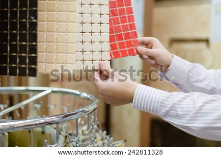 hands of choosing buyer or employee presenting colorful samples, closeup picture - stock photo