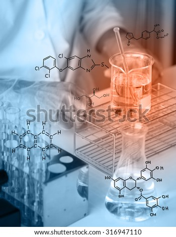 Hands of clinician holding tools during scientific experiment ,Researcher is dropping the reagent into test tube, with chemical equations background, in laboratory - stock photo