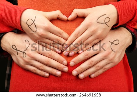 Hands of couple with inscription Love, close-up view