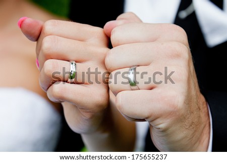 Hands of couple with wedding rings