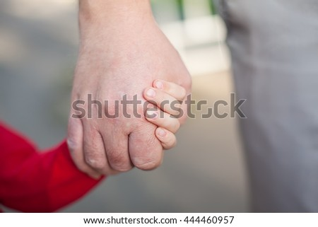 hands of dad and daughter
