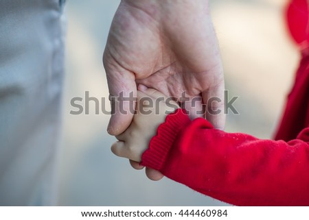 hands of dad and daughter - stock photo
