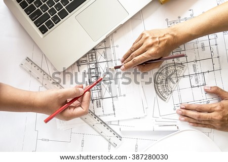 Hands of Engineer working on blueprint,Construction concept. Engineering tools.Vintage tone retro filter effect,soft focus(selective focus) - stock photo